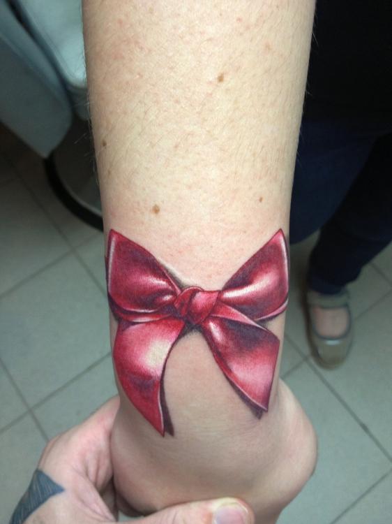 Выбором татуировки с фото уже готовых